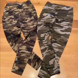 Two pairs of camouflage leggings.